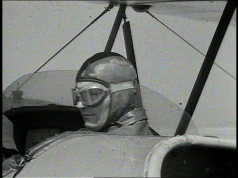 b/w 1941 close up head of pilot with goggles in open cockpit of bi-plane turning around / aero'nutics - propeller aeroplane stock videos & royalty-free footage