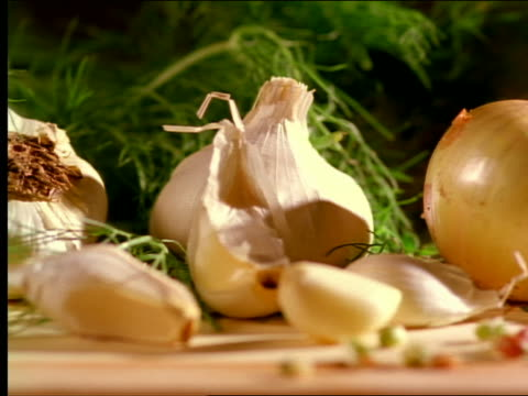 pan close up healthy foods laying out on table / garlic, onions, cinnamon, ginger, sprouts, celery - garlic stock videos & royalty-free footage