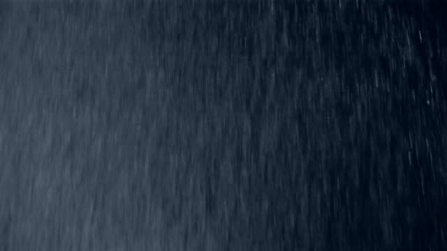 close up heavy rain falling against a black background - black background stock videos & royalty-free footage