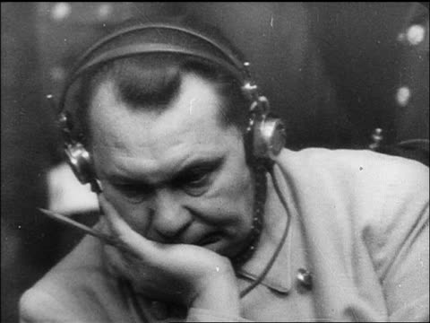 b/w 1945/46 close up hermann goering listening on headphones at war crime trials / nuremberg / documentary - einzelner mann über 30 stock-videos und b-roll-filmmaterial