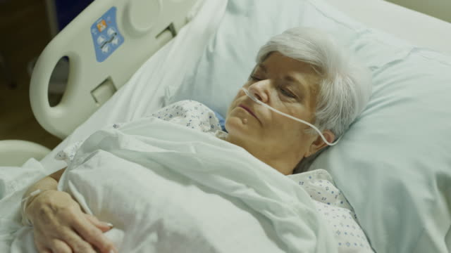 vidéos et rushes de close up high angle view of older woman sleeping in hospital bed / salt lake city, utah, united states - inhaler