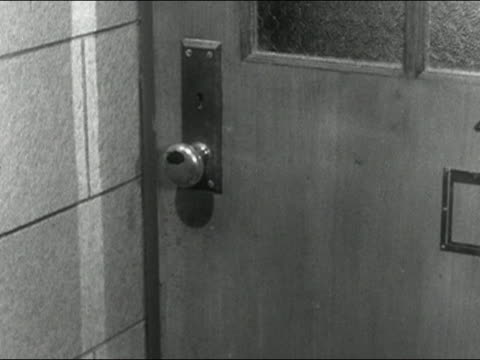 1955 close up high school boy turning dirty, germ-covered doorknob and entering room / audio - prelinger archive stock-videos und b-roll-filmmaterial