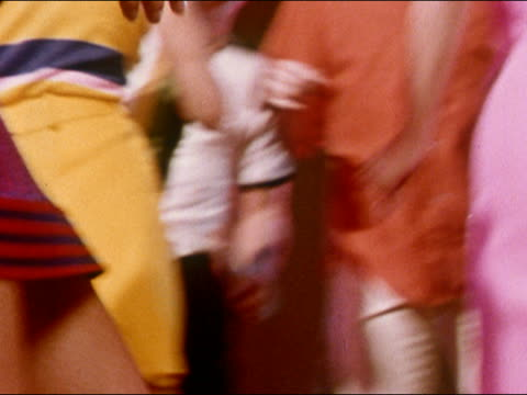 1968 close up hips and thighs of young women dancing in miniskirts at party