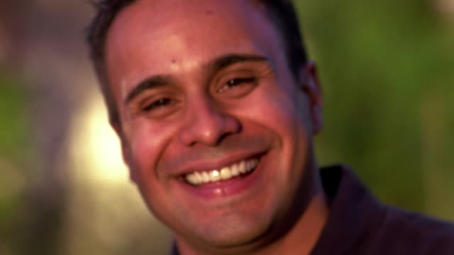 Close up Hispanic man smiling and laughing