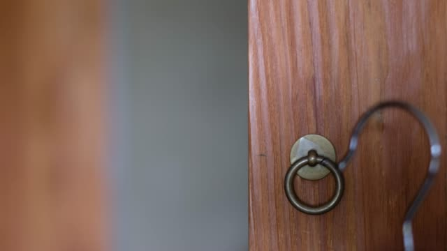 close up hook of coat hanger hang on wardrobe handle - hook stock videos and b-roll footage