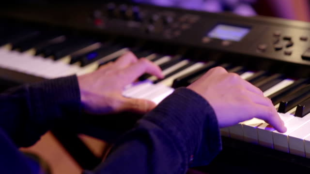 close up human hand playing piano at concert party - musical instrument string stock videos and b-roll footage