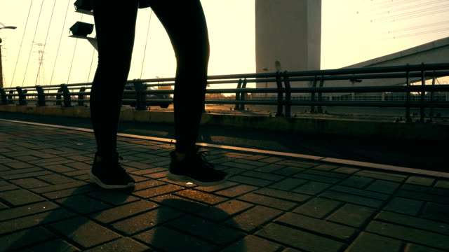 close up human leg walking on a bridge with sunlight - human foot stock videos & royalty-free footage