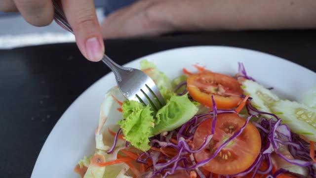 close up , huuman hand eating salad - salad stock videos & royalty-free footage