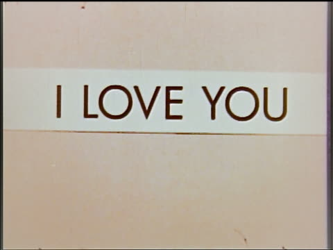 1954 close up 'i love you' banner with beige background - 1954 stock videos and b-roll footage