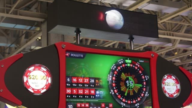 close up, illuminated signage for a roulette gaming machine at the global gaming expo inside the venetian macau resort and casino, operated by sands... - macao stock videos & royalty-free footage