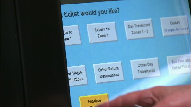 close up index finger pressing display on touch screen of london underground (tube) ticket machine/ london - 2005 stock videos & royalty-free footage