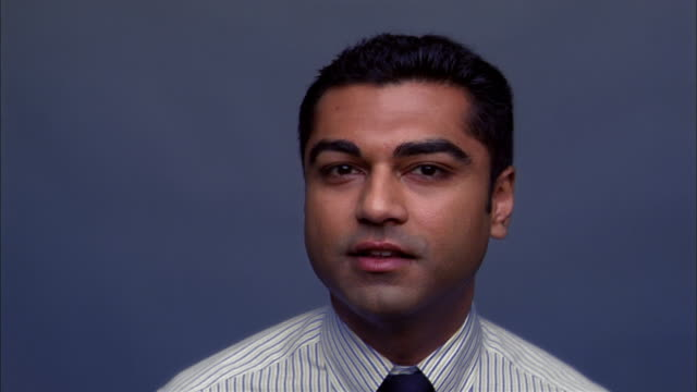 close up indian man in shirt and tie smiling at cam in studio - shirt and tie stock videos & royalty-free footage