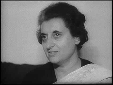 b/w 1966 close up indira gandhi sitting talking / newsreel - indira gandhi stock videos & royalty-free footage
