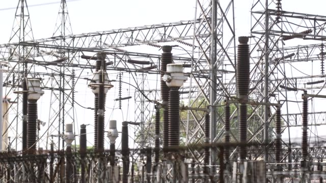 vidéos et rushes de close up insulators and cables at an electrical power substation in yangon myanmar on tuesday march 7 close up transformer at an electrical power... - processus biologique