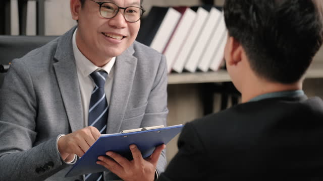 close up interviewer interview candidate and evaluation performance when apply for job at meeting room in office. - performance stock videos & royalty-free footage
