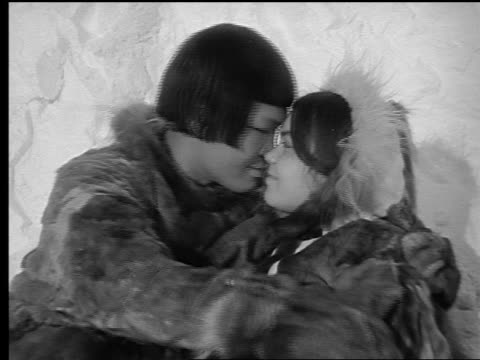b/w close up inuit couple rubbing noses together + smiling - kissing stock videos & royalty-free footage