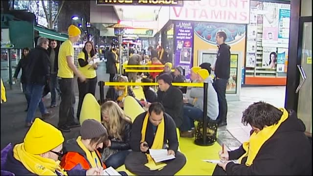 close up iphone 4 and turned over / kelly rowland at optus store launch holding iphone 4 / night customers queue sitting on ground outside optus... - 一等賞点の映像素材/bロール
