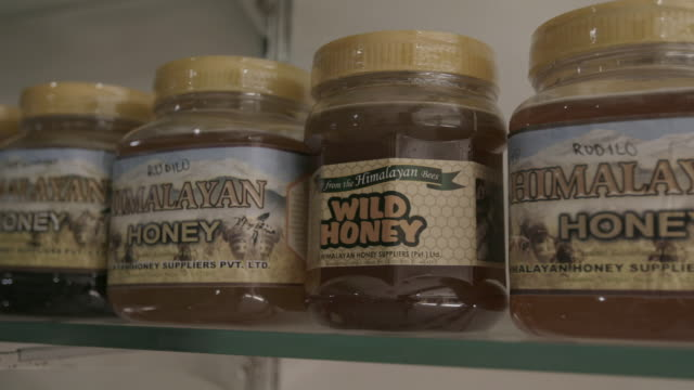 close up, jars of himalayan honey - seal stamp stock videos and b-roll footage