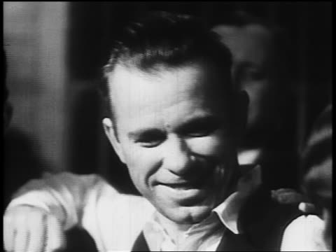 b/w 1934 close up john dillinger posing smiling with sheriff lillian holley prosecutor robert estill - john dillinger stock-videos und b-roll-filmmaterial