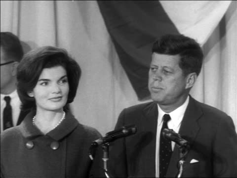B/W 1960 close up John Kennedy making speech at victory press conference / Jacqueline next to him