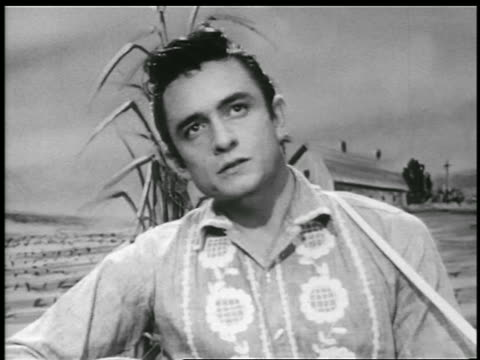 b/w 1956 close up johnny cash playing guitar singing home of the blues / farm backdrop / music video - johnny cash stock videos & royalty-free footage