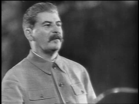b/w 1937 close up joseph stalin giving speech / russia - ex unione sovietica video stock e b–roll