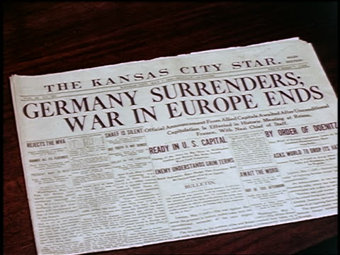 1945 close up kansas city star newspaper headline germany surrenders war in europe ends - ve day stock-videos und b-roll-filmmaterial