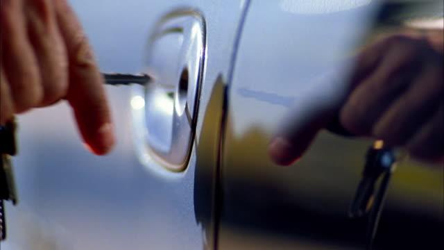 Close up key opening car door