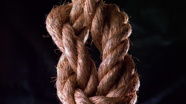 Close up knot in rope tightening