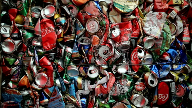 Close up large number of aluminum drinks cans for recycling.Recycled crushed tin can bale stacks