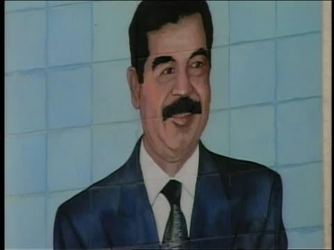 2003 close up large poster of saddam hussein / iraq - saddam hussein stock videos & royalty-free footage