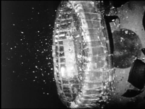 b/w high speed close up lead ball smashing into television tube(?) - demolished stock videos & royalty-free footage