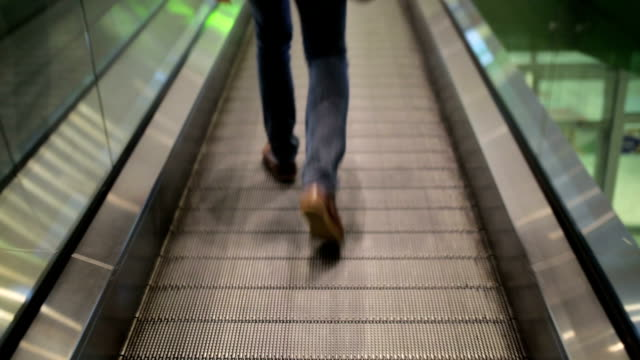close up leg of men wear jeans, leather shoes - stair lift stock videos and b-roll footage