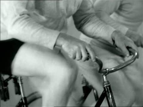 vídeos y material grabado en eventos de stock de b/w 1926 close up legs of babe ruth riding exercise bicycle / documentary - 1926