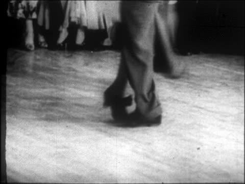 vídeos de stock, filmes e b-roll de b/w 1927 close up legs of black couple dancing lindy hop on one leg in harlem nightclub / nyc / newsreel - 1920