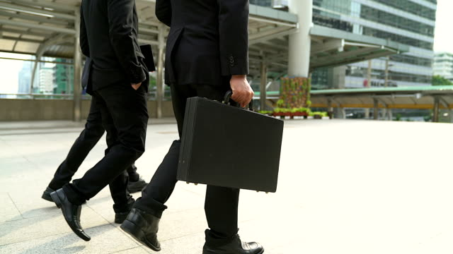 Close up legs of businessman walking stepping up stair in modern city, business growth, go up, success, grow up business concept