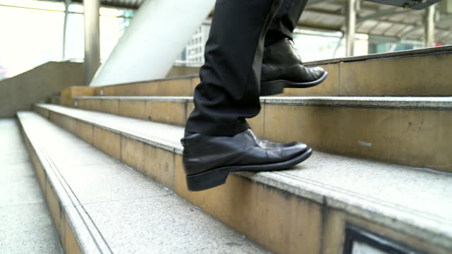 close up legs of businessman walks with his briefcase up stair in modern city, business growth, success, grow up. business concept. - staircase stock videos and b-roll footage
