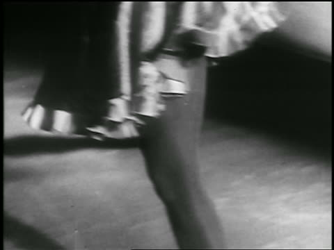b/w 1935 close up legs of female figure skater skating on ice / richmond canada - 1935 stock videos & royalty-free footage