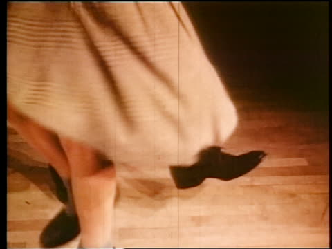 vidéos et rushes de 1945 close up legs of teen couple swing dancing / industrial - rock