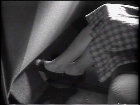 B/W 1937 close up legs of woman sitting in backseat of 1938 Ford V-8 car / commercial