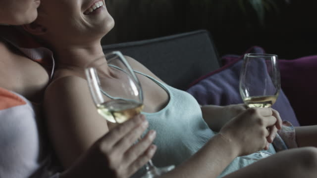 close up, lesbian couple sip white wine - camisole stock videos & royalty-free footage