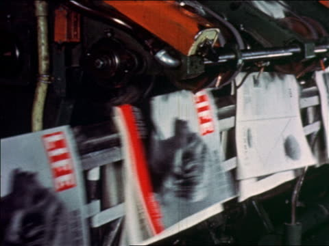 vidéos et rushes de 1952 close up life magazines being assembled on printing press - magazine