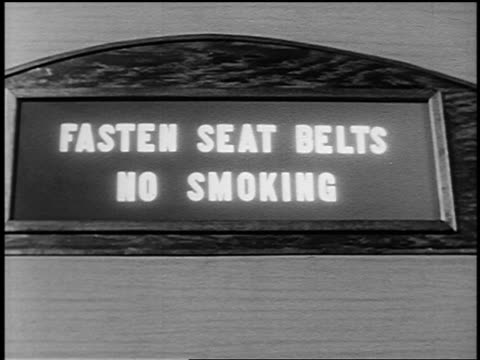 "b/w 1951 close up light goes out on ""fasten seat belts / no smoking"" sign on airliner - yorkville illinois stock videos & royalty-free footage"
