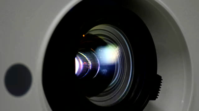 close up  light in  projector lens. - projection equipment stock videos and b-roll footage
