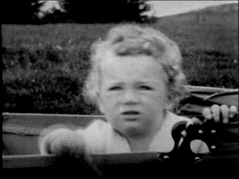 movie close up lindbergh baby sitting in baby carriage outdoors - pushchair stock videos and b-roll footage