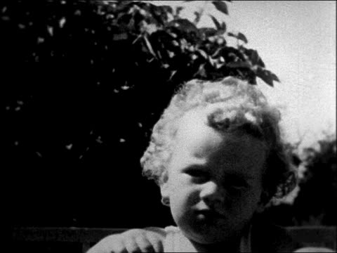 movie close up lindbergh baby sitting in crib outdoors - anno 1931 video stock e b–roll