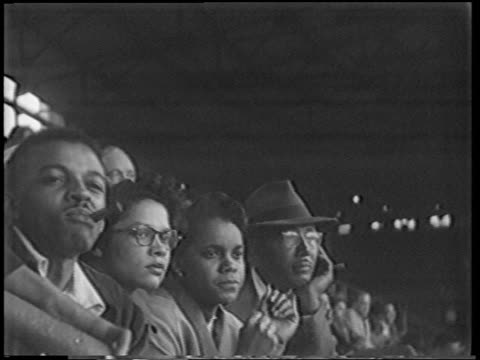 vídeos y material grabado en eventos de stock de b/w 1951 close up line of black people in audience watching playoff game intently/ one smoking cigar / nyc - 1951