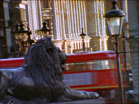 close up lion on fountain in trafalgar square / traffic on whitehall street in background / london - 1997 stock videos and b-roll footage