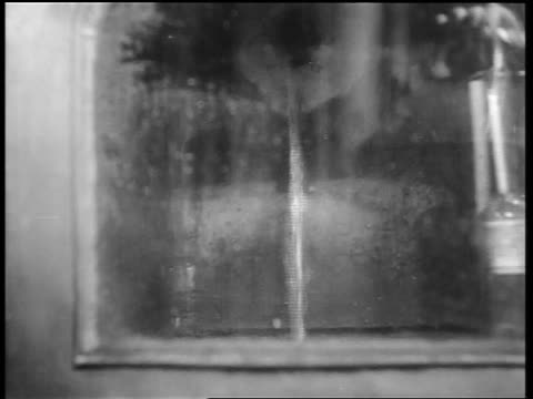 b/w 1932 close up liquid pouring out of hole in tank / whiskey production louisville ky - distillery still stock videos & royalty-free footage