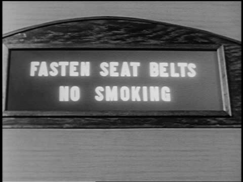 """b/w 1951 close up lit """"fasten seat belts / no smoking"""" sign in airliner - no smoking sign stock videos & royalty-free footage"""